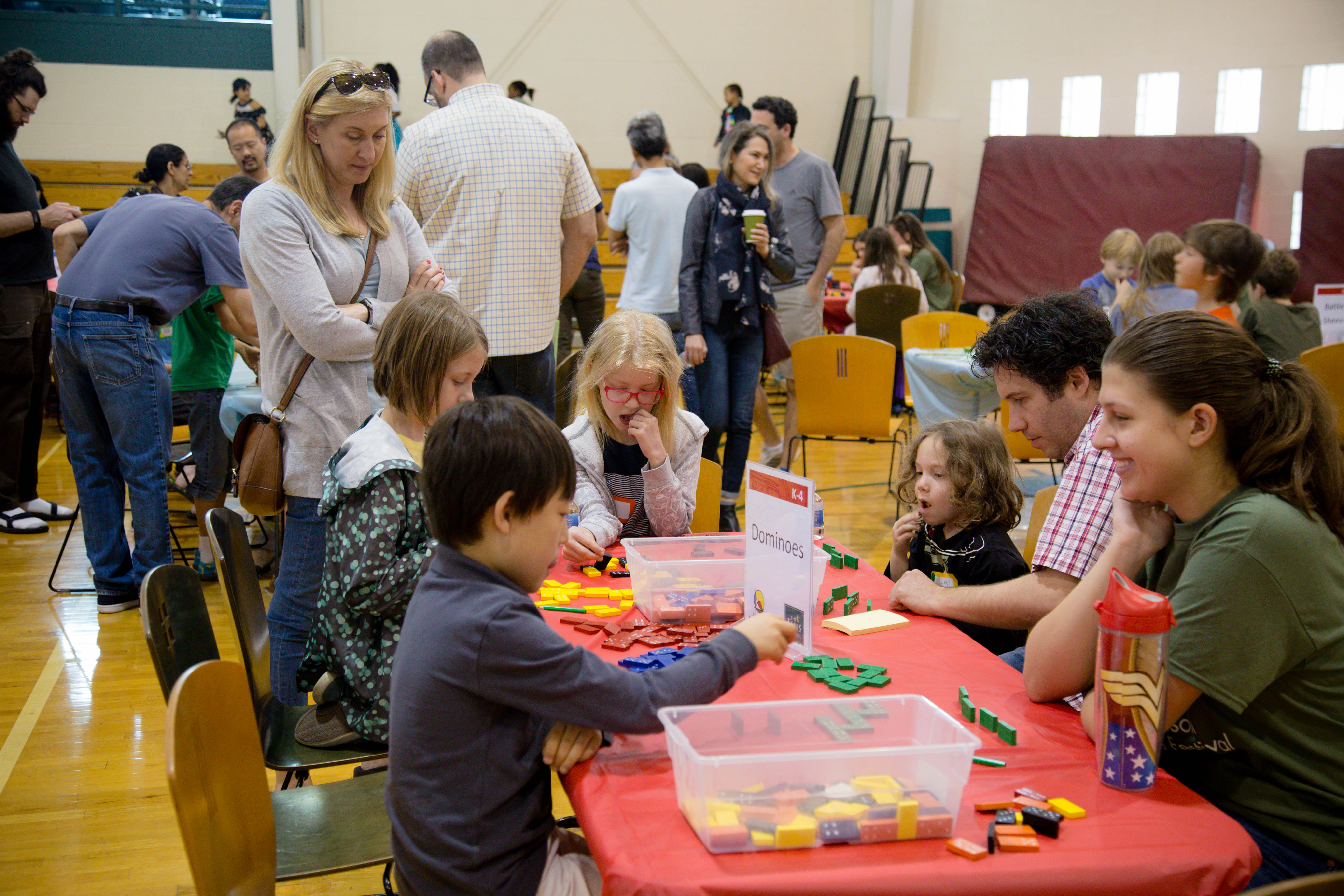 This is a photo of children playing math games at the Julia Robinson Mathematics Festival at The Ellis School.
